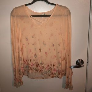 Flowy long sleeve top with 70s styled sleeves